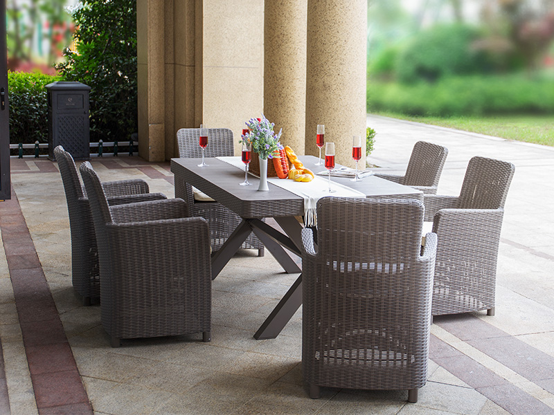 Outdoor plastic dining table and chairs